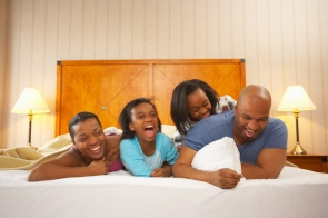 Family relaxing in hotel room