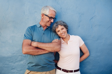 Beautiful mature woman standing with her husband