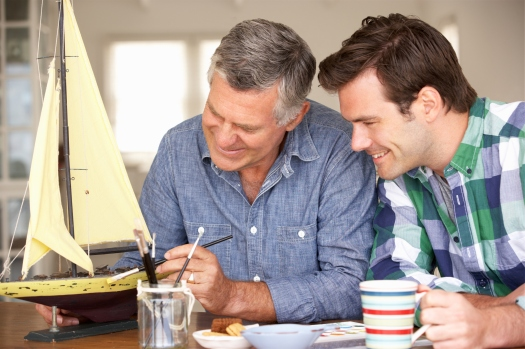 Adult father and son model making