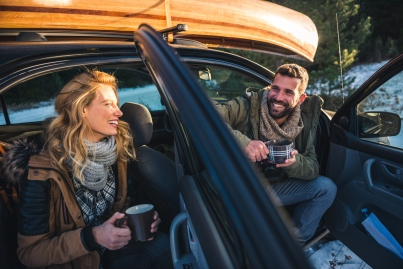 Couple enjoying roadtrip and making a break for coffee.